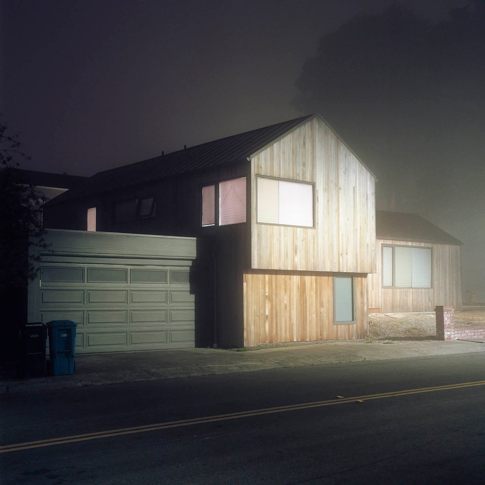 The Foggy Night, Untitled #2 by Kyle Kim - The Foggy Night is a film-based series of fine art color landscape photographs that focus on the San Francisco Bay Area. He started to analyze the structures, spaces (and places) and the systems that shape our lives and our landscapes and he focused on the area where we live at the interface of nature and culture.  This body of work is about the uncommon beauty of the urban landscape on foggy nights. The various color and lights appear one by one in the night scenes. He accidentally stumbled upon these elements, and it was like being transported into another world. The world moves slower with fog and lots of things disappear into the darkness. It is within this landscape that he has found solace and peace within himself as his camera turns to the unusual attractiveness of the night.  The fog soaks into the color of the artificial lights, and transforms it. Due to the continued transformation, the night lights never disappoint him as they show a different face with each visit, revealing their strange elegance. As viewers explore the work, he intends for them to experience the unique beauty that is hidden in the night. - photography, film, color, light, foggy, fineart, landscape, nightphotography